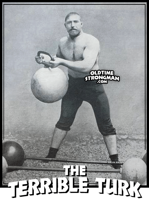 Ahmed Madrali, The Terrible Turk, lifts a large kettlebell.  Two globe barbells are at his feet.