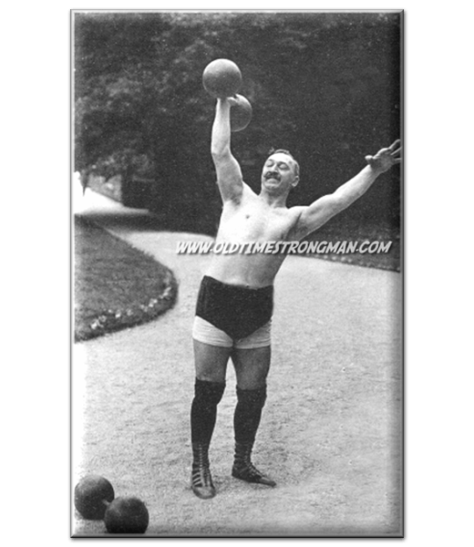 French Strongman Jean Francois LeBreton lifts a Globe Dumbbell overhead