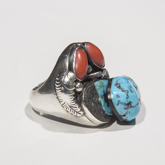 Before our expert repairman Henry Yazzie got a hold of this ring, it needed a lot of help! Note the backing on each of the stones.