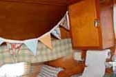 Picture of a 1954 Shasta 1400 vintage Travel Trailer, showing child's cot over the fold-out bed