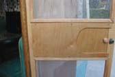 Custom made birch screen door in vintage 1955 Shasta trailer
