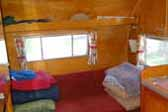 Gaucho bed setup as a couch in a 1960 Shasta Airflyte vintage trailer