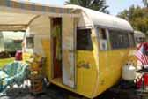 Sharp vintage Shasta Travel Trailer painted bright yellow and white