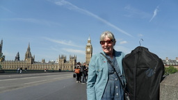 Mother and suit, on their way through London.