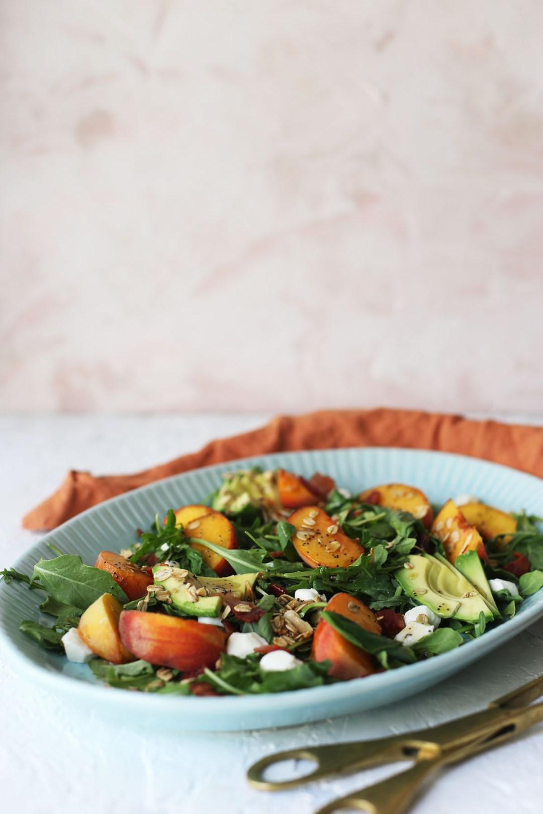 Arugula Peach and Crispy Bacon Salad with Maple Granola