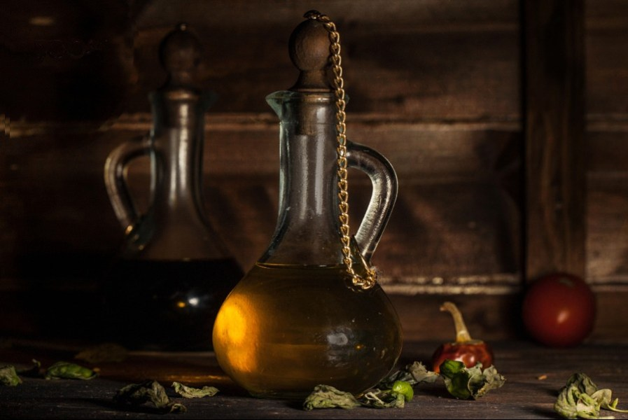 500px Photo ID: 25672549 - Vintage bottle of olive oil with herbs and tomato