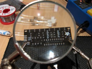 Magnifying the Circuit Board CC BY Andrew Mason