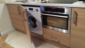Modern Washer/Dryer and Electric Oven+Microwave fully integrated