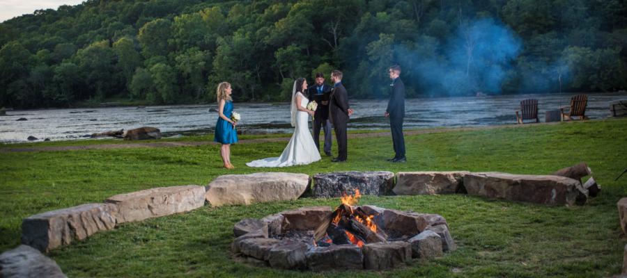 A riverside bonfire at Olivette, wedding venue in Asheville, NC.