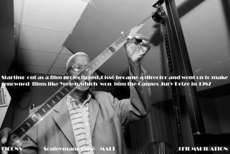 Souleymane_Cissé_with_film_reel