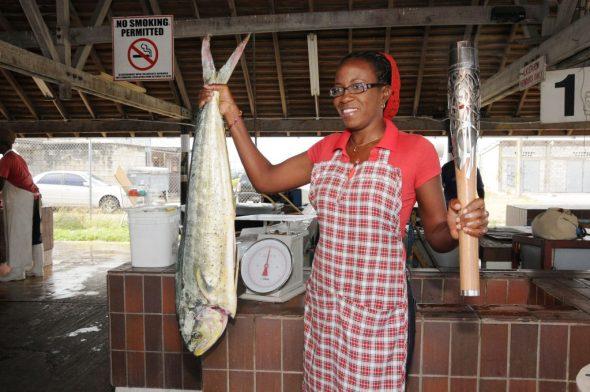 Fish vendor, Natasha Clarke, holding the Baton at Oistin's Fishing Village