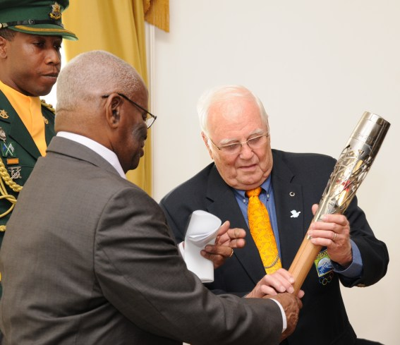 The Governor General of Barbados (left) presents the baton to President of the BOA, Steve Stoute (right)