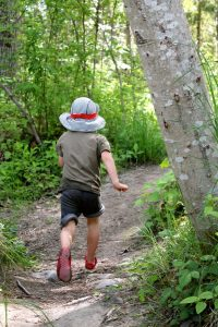 Child running on the trail