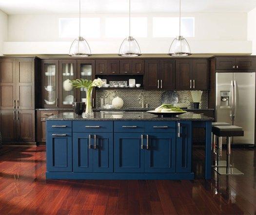 Dark Wood Cabinets With A Blue Kitchen Island
