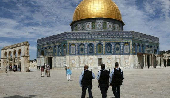 Israeli police officers walk in front of the Dome of the Rock, on the Temple Mount. March 17, 2010. (photo by REUTERS/Baz Ratner)