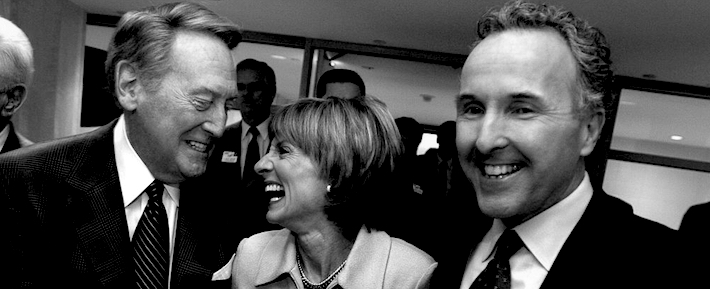Wally Skalij –– – 076950.SP.0129.dodgers1.WS New Dodgers owner Frank McCourt, right, with his wife Jamie and announcer Vin Scully are all smiles in the Stadium Club before a press conference at Dodger Stadium Thursday.
