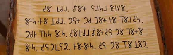 A carved text in Mro