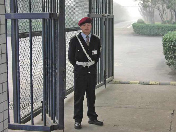 A private security guard at a Chinese factory in February 2004.