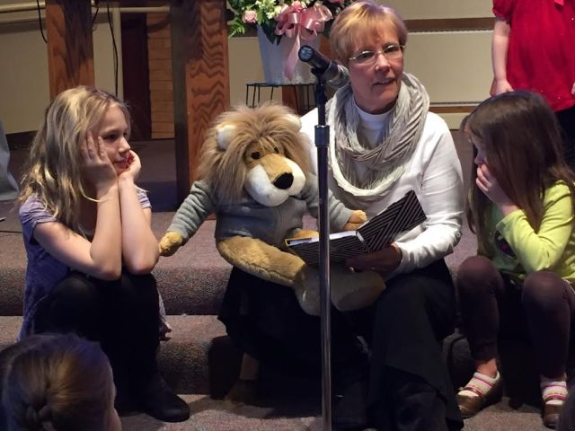 Leo the Lion and Peg Benz lead children's time.