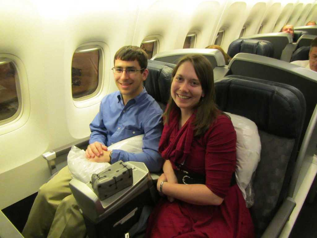 Jenn and her husband sitting in First Class
