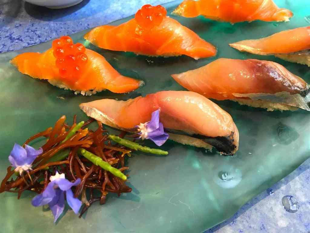 Salmon and marinated mackerel with cauliflower in vinegar