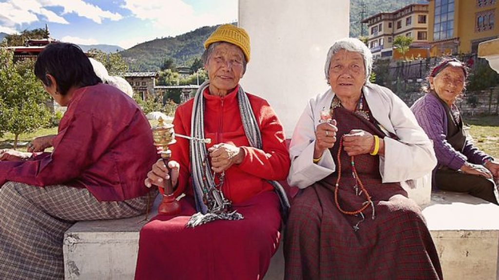 Elderly Bhutanese women praying at the National Memorial Chorten