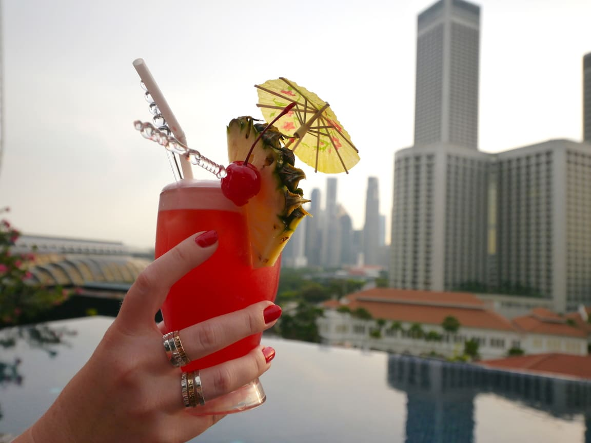 Cocktails at Cloud Nine Naumi rooftop pool