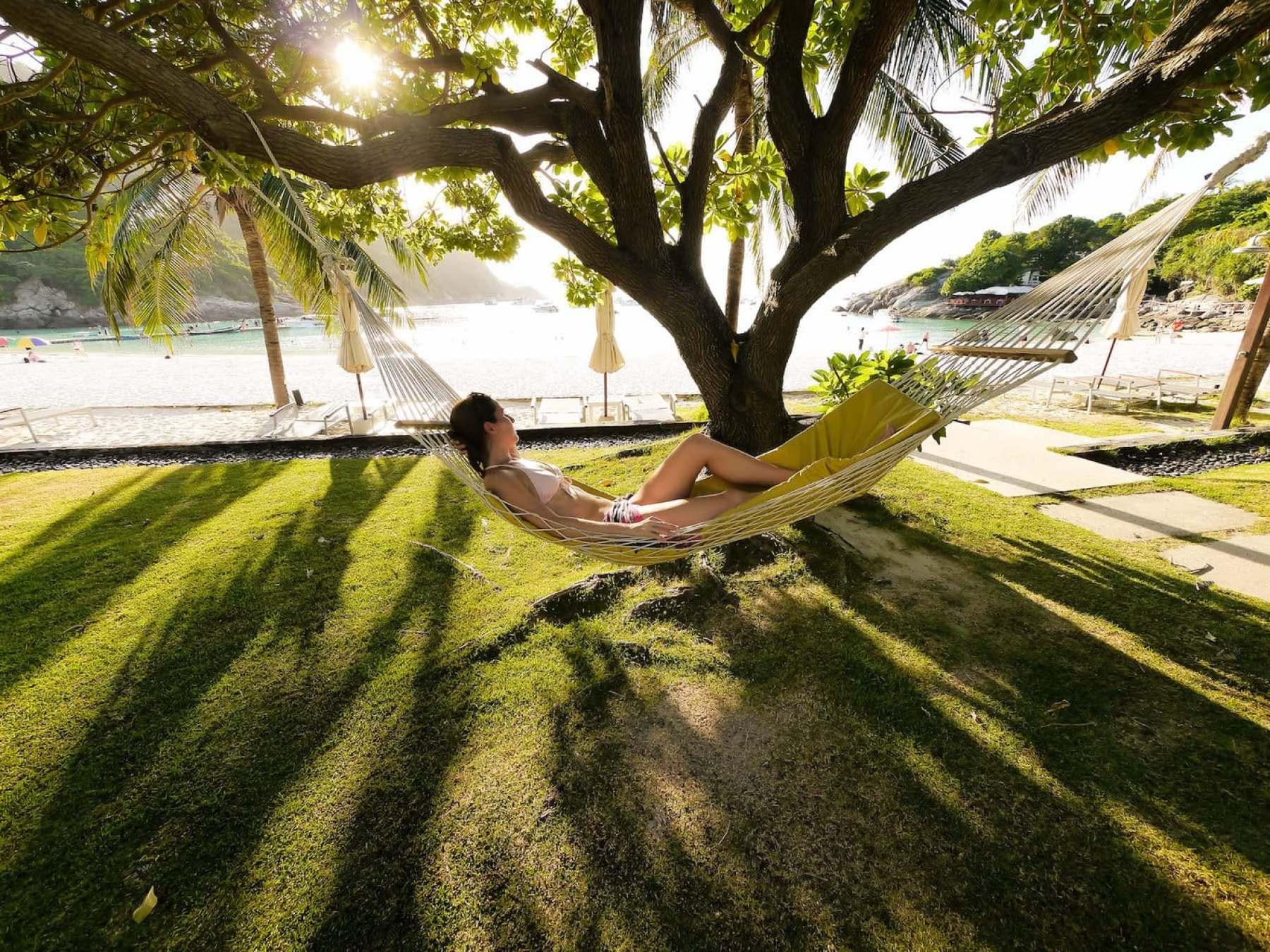 Lounging on a hammock, enjoying the rays of sun