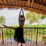 Yoga stretching with a great view of Cempedak Island