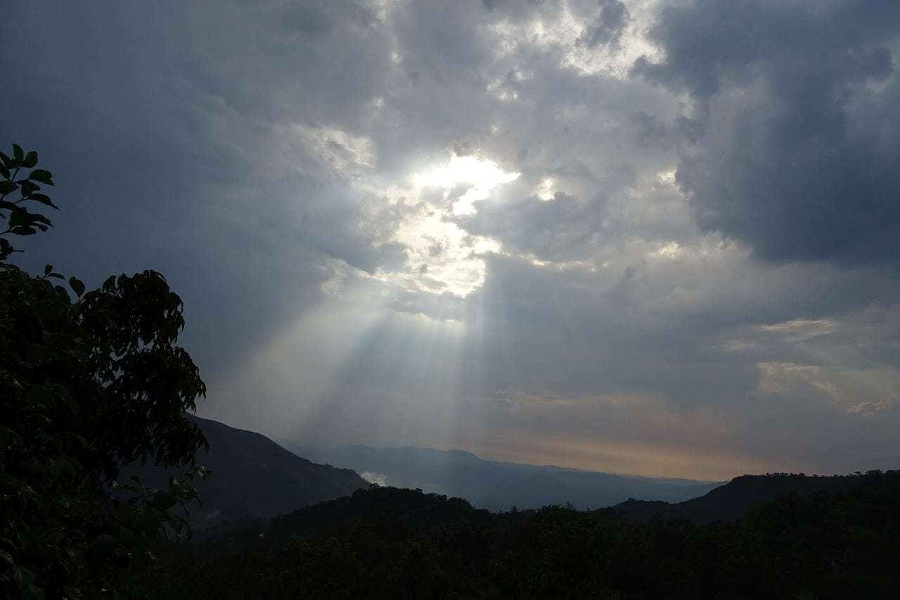 Sun escaping through the clouds in Agumbe