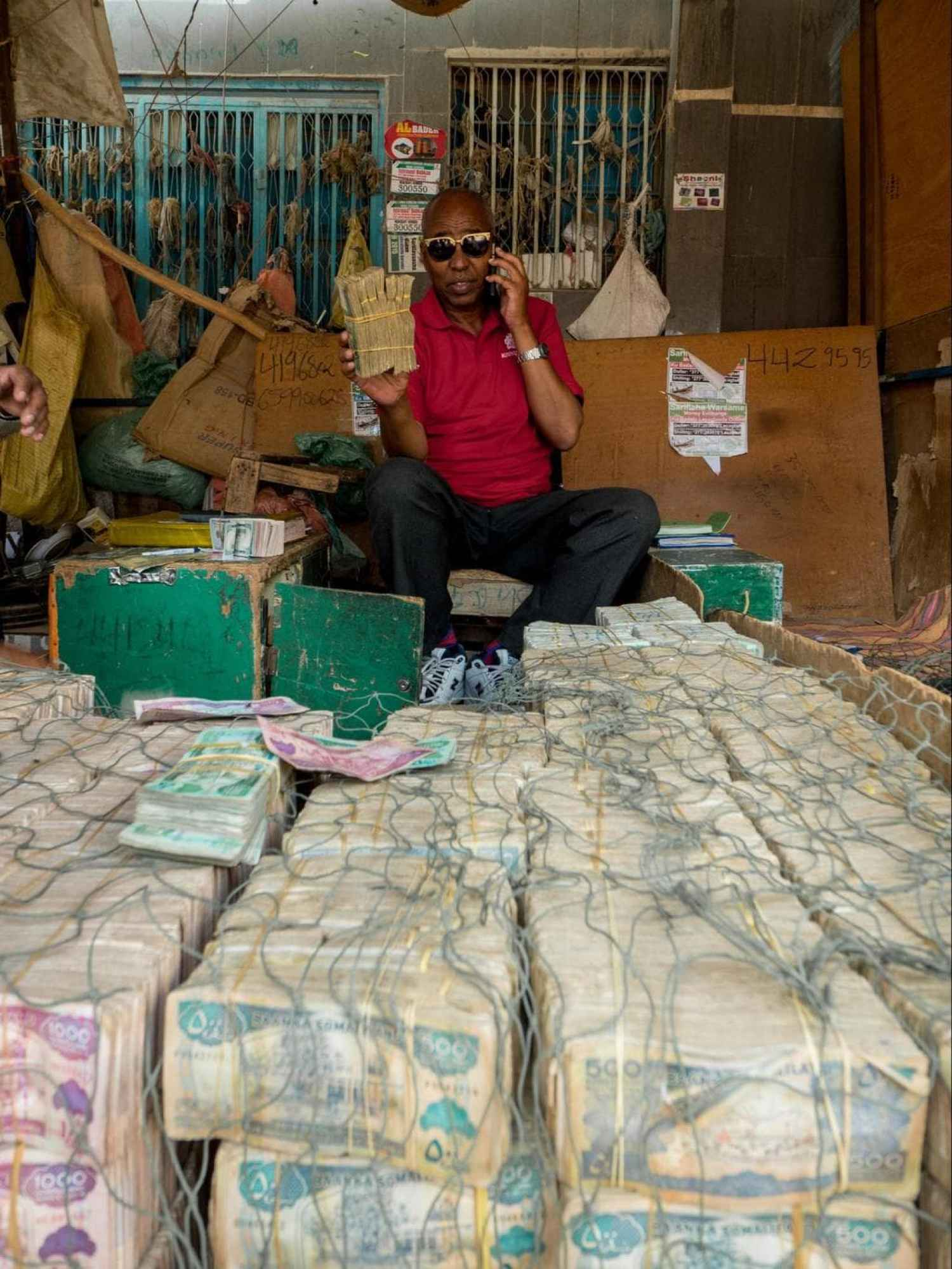 Money changer showing me his stack of Somali Shilling