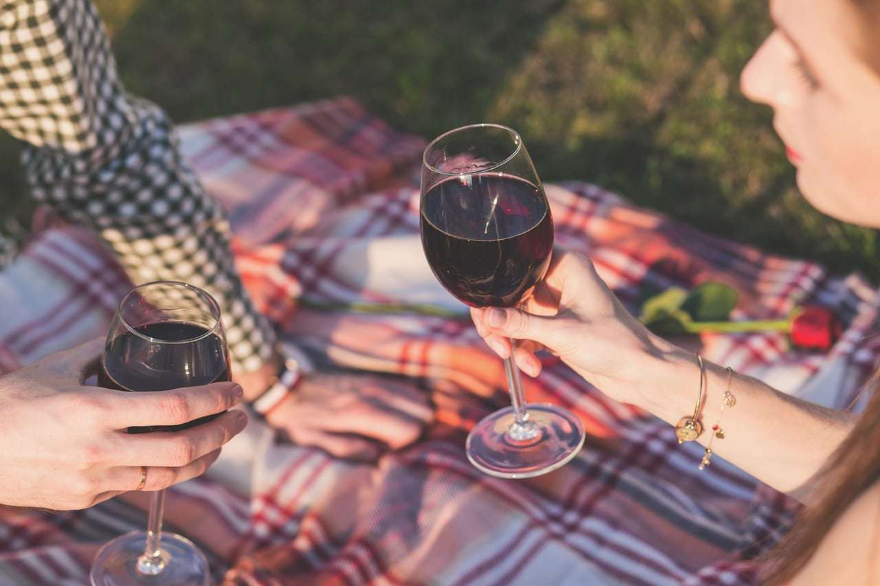 Everyone enjoys a glass of wine with friends
