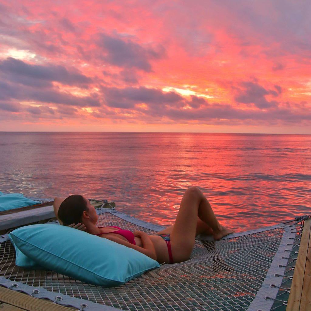 Gazing at the sunset at Soneva Fushi