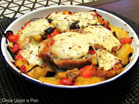 Roasted pork chops with aubergines, potatoes and mozzarella