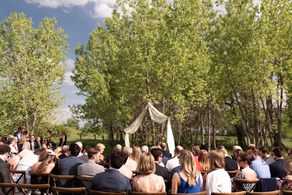 Guests gather for an outdoor wedding ceremony at Kelly Urban Farm in Boulder, Colorado.