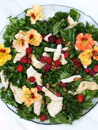 RASPBERRY KALE SALAD WITH EDIBLE FLOWERS