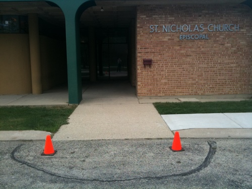 "St Nicholas Episcopal ""happy face"" with traffic cones and construction paint"