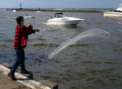 Hand-net fishing on Lake Michigaan