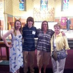 Anna and Tommy Dowd, with their mother and grandmother, after being confirmed at St James Cathedral.