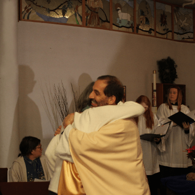 FatherMannyPeaceHugXmas2013