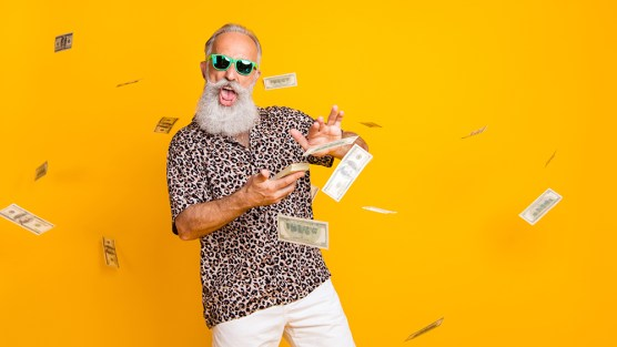 happy old man playing in money - OneCity Technologies Pvt Ltd