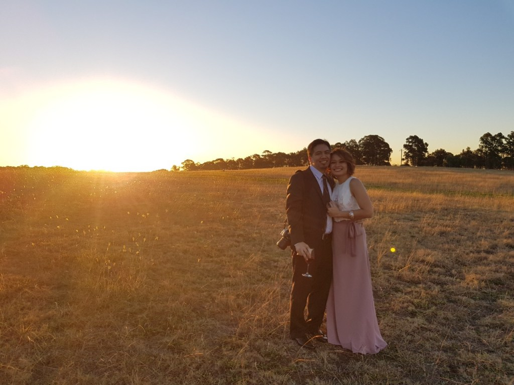 Couple posing by sunset