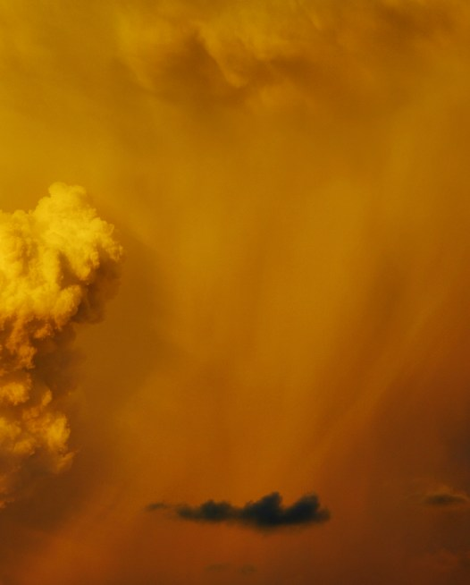 A horizontal photo of Australian Landscape in a Summer afternoon with orange and yellow clouds.