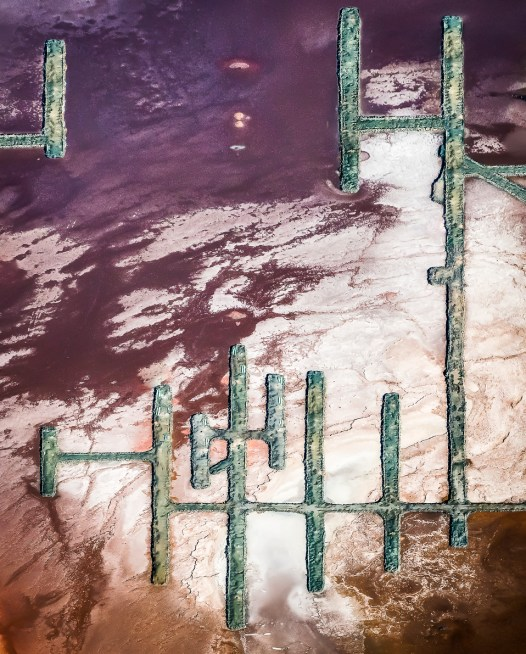 A Vertical Abstract Aerial photo of Australian Landscape in Pink, Purple and Red