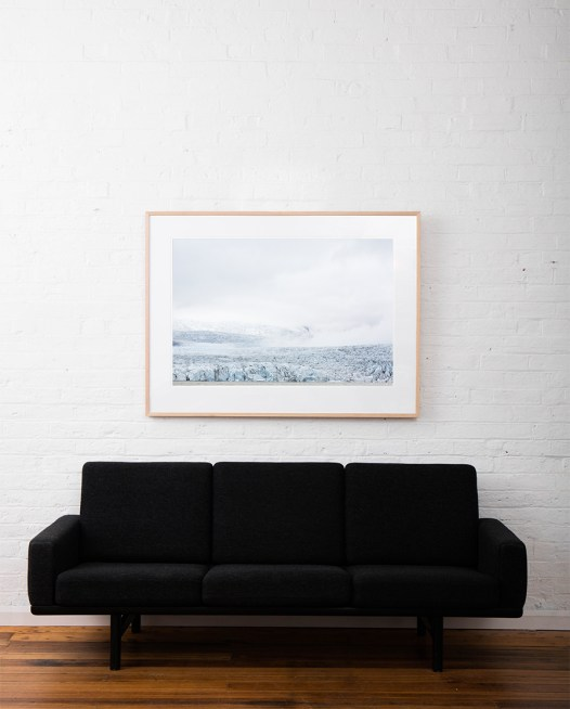 Large Iceland Lanscape of Falling Glacier in blue and whilte. Framed in raw timber on white wall above sofa