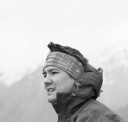 a photographer of Christopher Tung with cloud and mountain background