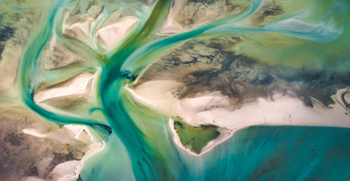 A Abstract Aerial Landscape of water in blue and green