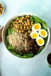 Spinach salad with farro, crispy chickpeas and warm bacon dressing