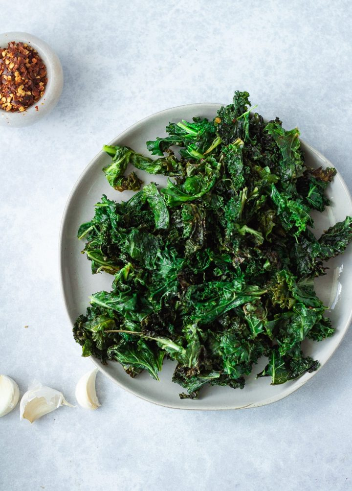 sautéed kale on plate with garlic and red pepper flakes