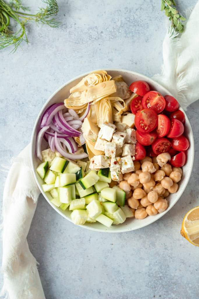 separate ingredients for greek salad on small plate